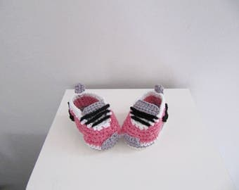 Pink and white cotton baby shoes