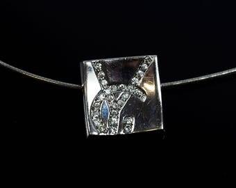 Yves Saint Laurent Silver Pendant