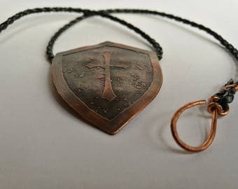 Knights copper shield pendant on a black leather necklace