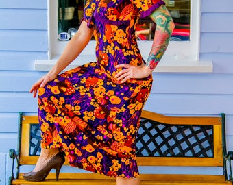 1970s vibrant patterned long dress, big yellow brown and purple print.