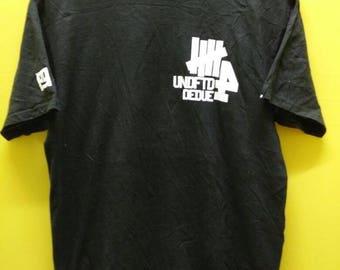Vintage UNDEFEATED BIG LOGO T Shirt Rare