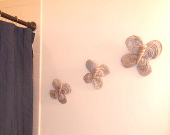 Butterfly wall hangers made from real fossils