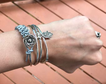 Silver leather wrap bracelet with charm