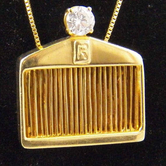 14k yellow gold rolls royce pendant with 063 carat quality like this item aloadofball Choice Image