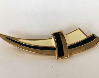 Monet signed black and cream enamel and gold tone brooch