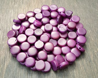 Tagua nut coin beads 9-10mm purple, vegetable ivory tagua nut 9-10mm coin beads.