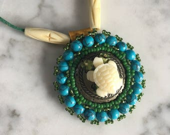Turtle Island, turquoise beaded pendant/ medallion