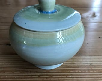 pale green lidded container