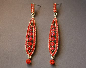 Chandeliers, earrings from the 50s with bright orange-color rhinestones, unworn and very rare.
