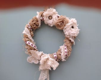 Hessian shabby chic wreath decorated with shabby and hessian flowers.