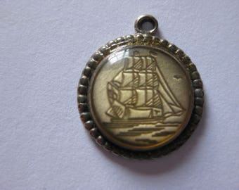 tiny vintage fort ship pendant
