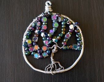 Wire-wrapped Tree of Life pendant or sun catcher with iridescent purple and blue beads on silver wire