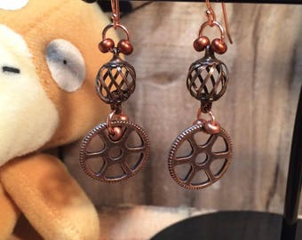 Copper steampunk gear earrings.