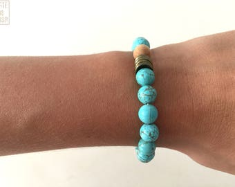 Beaded bracelet turquoise and wood with uneven bronze rings
