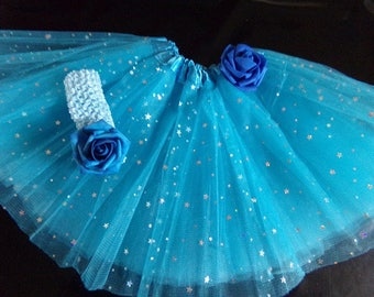 Blue Tutu has silver glitter and matching headband