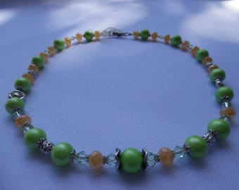 Necklace gemstones and swarovski green and yellow.