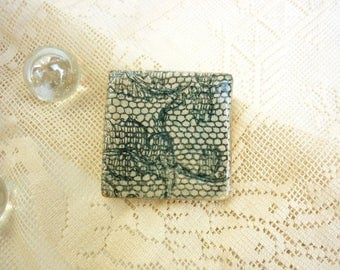 earthenware inspired textile brooch gray lace
