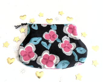 Pouch / bag / fabric / stylized flowers / black background.
