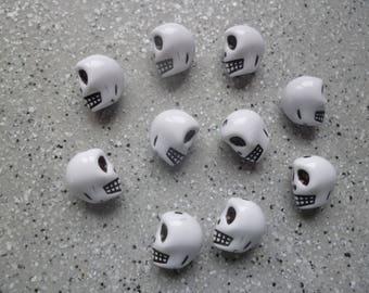 10 beads in white resin skulls
