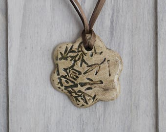 Ceramic pendant shaped flower print Asian motifs and branches