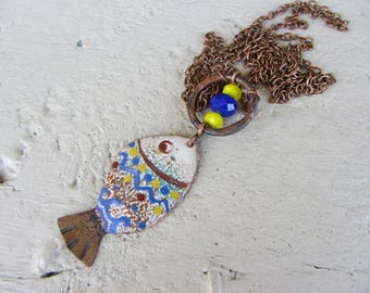 fantasy fish enameled copper, hammered copper ring, yellow and bright blue glass beads