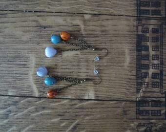 "Bronze earrings in ""two-tone cerebro and balisier acai seeds"