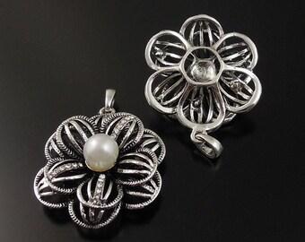 2 Breloques fleur ouvragée en 3 D et sa perle dimensions 39*36*16mm