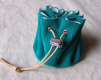 Purse is Mint green suede leather