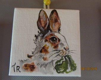 animal miniature depicting a Bunny head