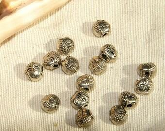 x 10 0.7x0.6 mm Tibetan silver Buddha head bead