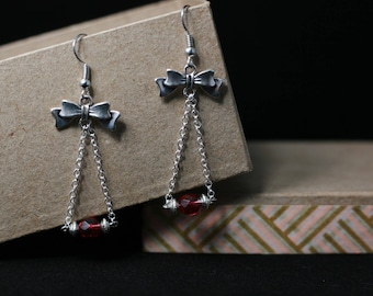 Bow and Red faceted beads