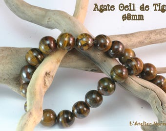 """Pearl agate """"Eye of Tiger"""" brown gold ø8mm * to the unit *."""