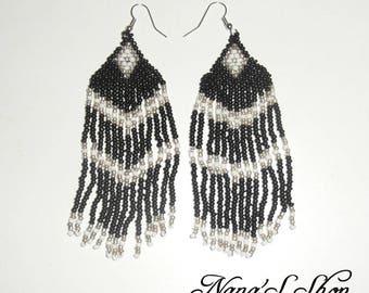 Earrings woven black, white details.