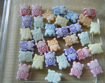 set of 29 frog shaped multicolored beads