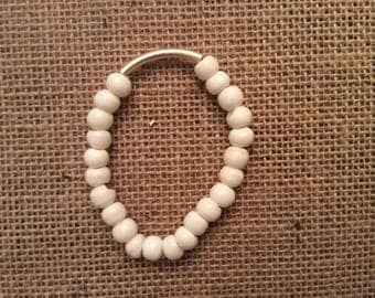 Gold and bone bead bracelet