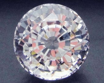 White sapphire, 6.7 carats 11.4 mm by 6.8 mm, round brilliant faceted, lab diffusion