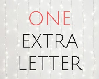 One additional letter neon sign
