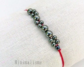 This bracelet with a multitude of pearls hematite cord Ref fuchsia stone: M017