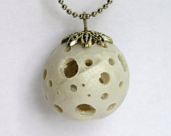 Polymer clay necklace, ball holes with Bell