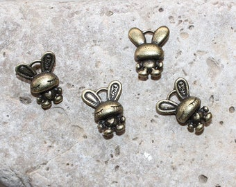 a set of 4 charms shaped Bunny standing bronze 13 mm X 16 mm