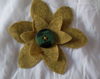 felt with a button brooch