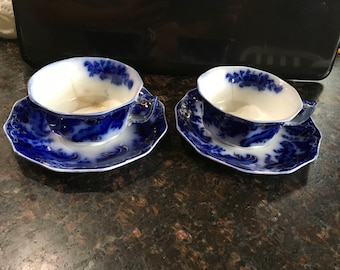 Antique flow blue china tea cup saucer