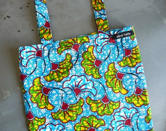 tote bag in wax, ibiscus patterns, blue green yellow Burgundy white