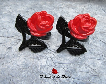 Two black and red rose napkin rings