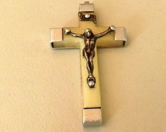Cream and silver metal cross pendant