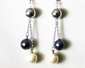 Earrings with pearls on stainless steel chains