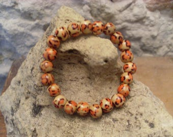Elastic bracelet with 2 wooden beads