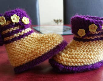 Pair of hand knitted baby booties