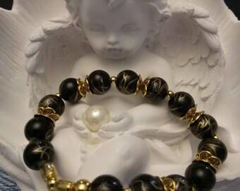 Black and gold glass beads bracelet