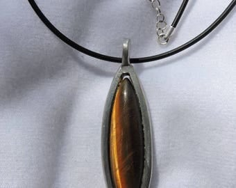 Tiger's eye pendant set with pewter leather cord